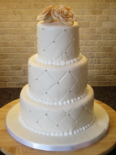 Ivory-White-Qulited-Rose-and-Silver-Pearl-Wedding-Cake